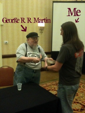 A picture from one of my better angles getting an autograph from a talented author.